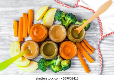 baby vegetable puree on wooden background top view