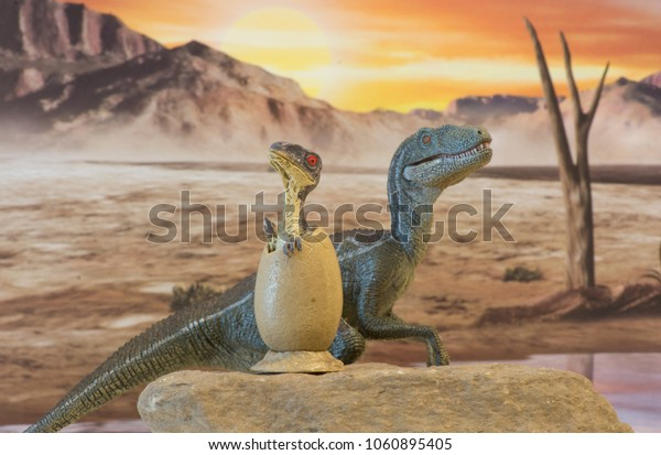 baby velociraptor into egg with his mother into jurassic era
