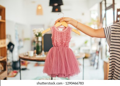 Baby waiting. Shopping for kid and mom. Children clothes in the shop