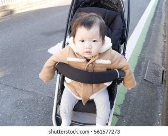 Baby walking on a stroller