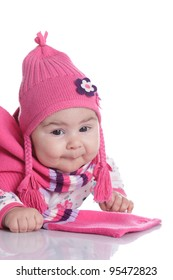 Baby weared in fashion hat with pigtails and scarf isolated on white