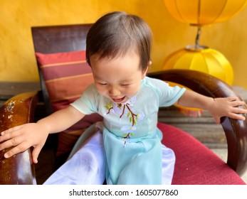 Baby wearing ao dai in Vietnam.
