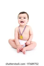 Baby wearing medal laughing