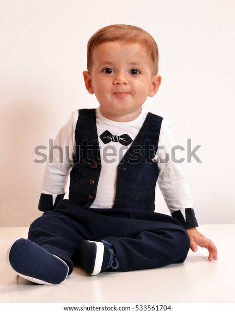 Baby wearing tuxedo suit portrait.