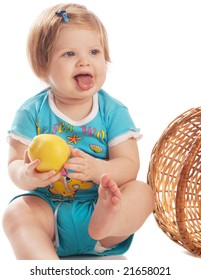 Baby with yellow apple, isolated