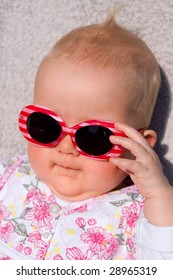 A baby-girl with sunglasses on