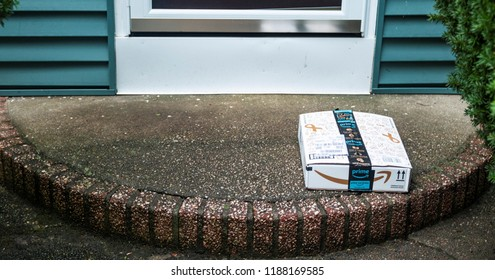 Babylon, New York, USA - 13 September 2018: A package is left on a front porch and is vulnerable to being stolen.