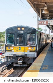 Babylon, New York, USA - 14 August 2018: A lirr train is arriving at the Babylon train station to pick up passengers heading west to Penn Station.