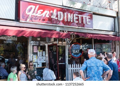 Babylon, New York, USA - 17 June 2018: Customers patiently wait fot a table outside of Glens Dinnette in Babylon Village on Fathers Day.