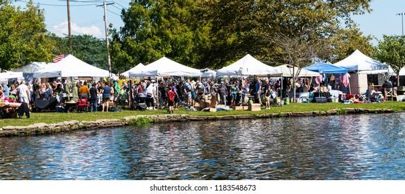 Babylon, NY, USA - 16 September 2018: Vendors line Argyle lake in Babylon village during the annual fair.