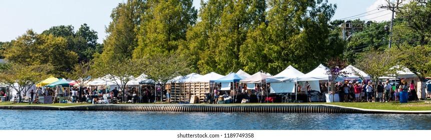 Babylon, NY, USA - 16 September 2018: Vendors back up against Argyle Lake in Babylon Village during the annual September fair.
