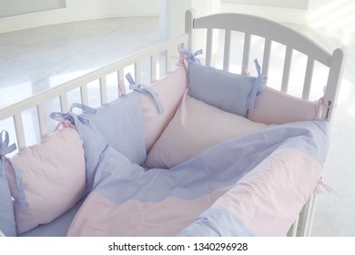 The baby's bed in the room