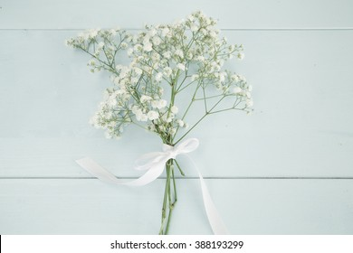 Baby's breath bouquet on wooden background