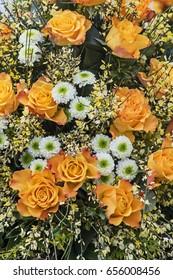 Baby's breath and orange roses