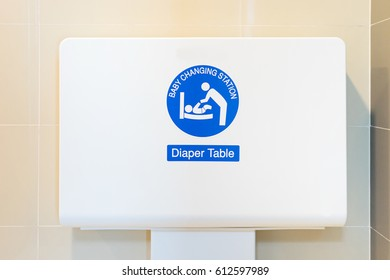 Baby's diaper table changing cloth station install in the wall at the airport restroom,selective focus