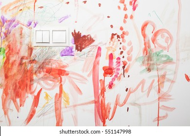 Baby's drawing with crayon color on the wall. Works of child. Abstract sketch background.