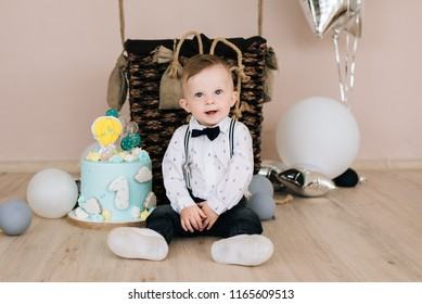 Baby's first birthday. Cute smiling baby is 1 year old. The concept of a children's party with balloons