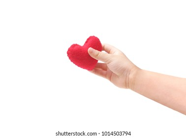 Baby's hand holding a red heart isolated on white background