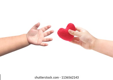 Baby's hands giving and taking a red heart isolate on white