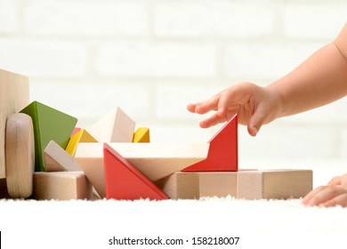 Baby's hands playing with building blocks