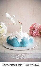 Babyshower and Newborn Cake in the form of a cloud and a stork with new baby