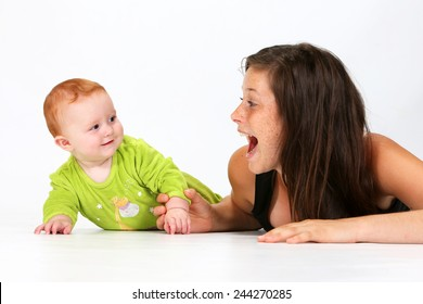 Babysitter playing with a baby