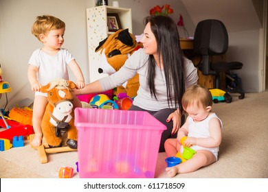 babysitter playing with children