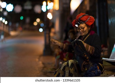 Bac Ha, Sapa, Vietnam - 08 17 2014: Ethnic Red Dao Woman at Bac Ha Market. Red Dao ethnic minority group from Sapa, Lao Cai, Vietnam