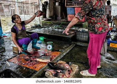 BAC HA, VIETNAM - AUGUST 26, 2018: Unidentified people buying and selling fish at Sunday market on August 26, 2018 in Bac Ha, Vietnam.