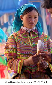 BAC HA, VIETNAM - NOV 21: Unidentified girl from the Flower H'mong Ethnic Minority People holds ice cream on November 21, 2010 in Bac Ha, Vietnam. H'mong are the 8th largest ethnic group in Vietnam