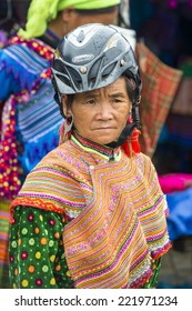 BAC HA, VIETNAM - SEP 21, 2014: Unidentified woman in tradtional ethnic dress at the Bac Ha Market, a large Sunday market with people wearing beautiful colored minorities costumes