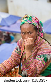BAC HA, VIETNAM - SEP 21, 2014: Unidentified Vietnamese people at the Bac Ha Market, a large Sunday market with people wearing beautiful colored minorities costumes