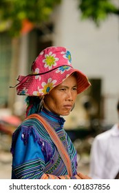 BAC HA, VIETNAM - SEP 21, 2014: Unidentified Vietnamese woman in tradtional dresses in Bac Ha town famous by a large Sunday market with people wearing beautiful colored minorities costumes