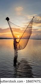 BAC LIEU, VIETNAM - JULY 24, 2018: Fisherman at Sea. Near Bac Lieu city. Nha Mat village. Morning view. Vietnam