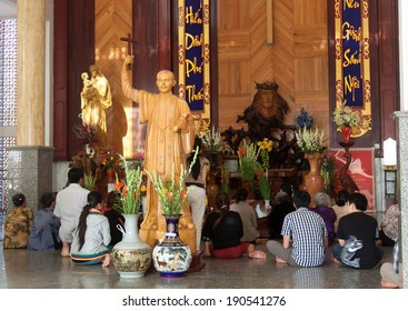 BAC LIEU, VIETNAM - MARCH 09: The faithful sitting around Buu Diep priest statue at Tac Say church, Bac Lieu, Ca Mau, Vietnam. Diep father is famous priest in south Vietnam. On march 09, 2012.