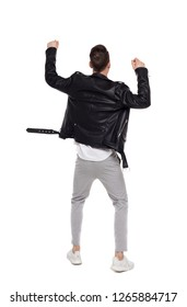 Bac view of a happy man in a leather jacket. Rear view people collection.  backside view of person.  Isolated over white background. Biker in pants dancing.