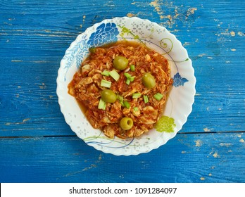 Bacalao a la Vizcaíba - Salt cod appears on Christmas Eve tables throughout Mexico, version of salt cod with almonds and olives comes