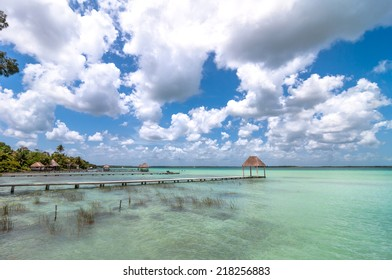 BACALAR, MEXICO - April 26, 2014: idyllic pier and palapa hut in Bacalar lagoon, Mexico. Bacalar was the first city in the region which the Spanish Conquistadores succeeded in taking in 1543