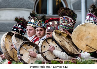 """Bacau, Romania - December 27, 2019: A group of romanian actors playing """"The Horses"""" during """"New Year's Day Romanian Tradition Festival""""."""