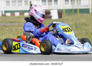BACAU, ROMANIA - SEPTEMBER 4: Alexandra Marinescu, number 403, competes in National Karting Championship, Round 6, on September 4, 2011 in Bacau, Romania.