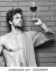 Bachelor enjoy wine. Macho tousled hair degustate luxury wine. Drink wine and relax. Erotic and desire concept. Man sexy chest sweaty skin hold wineglass. Guy attractive relaxing with alcohol drink.
