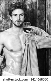 Bachelor enjoy wine. Macho tousled hair degustate luxury wine. Drink wine and relax. Erotic and desire concept. Guy attractive relaxing with alcohol drink. Man sexy chest sweaty skin hold wineglass.