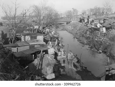 Bachelor shacks in outskirts of Paterson, N.J., 1936. Homes of about 25 men, some of them unemployed silk mill workers. The man in the photo is on relief and worked in the mills until 5 years ago