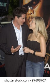The Bachelor star ANDREW FIRESTONE & fiance JENN at the world premiere, in Los Angeles, of S.W.A.T. July 30, 2003  Paul Smith / Featureflash