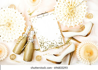 Bachelorette Party Planner. Clipboard mockup and Female shoes with golden decorations.  Flat lay, top view trendy holiday concept.