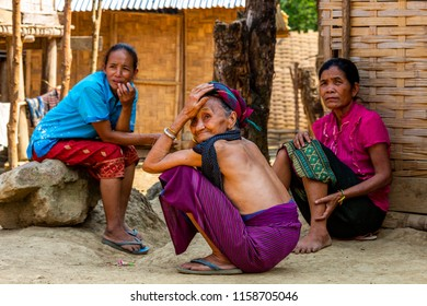 Bachong Nay,, Laos - April 10, 2018: Three women pertaining to a Lao ethnic minority sitting in front of a bamboo house in a remote village of Laos. Credit: Dino Geromella/Shutterstock