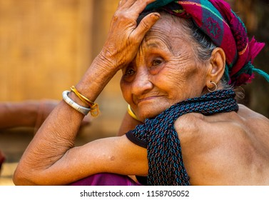 Bachong Nay,, Laos - April 10, 2018: Portrait of a senior ethnic minority woman living in a very remote village of northern Laos. Credit: Dino Geromella/Shutterstock