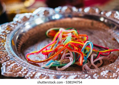 Baci cotton bracelets or the Good Luck bracelets that are used in Buddhist ceremony in Wat Luang Pakse is a ancient Buddhist temple in Pakse in south Laos