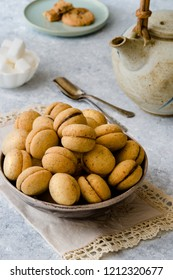 'Baci di dama': delicious chocolate cookies with hazelnuts and topping on delicate background