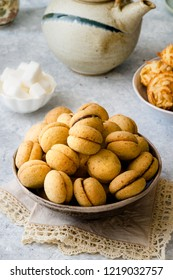 'Baci di dama': delicious chocolate biscuits with hazelnuts and topping on delicate background